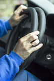The serviceman covenants the overlay on the steering wheel of the car. Stock Image