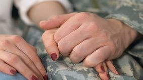 Serviceman and girlfriend holding hands closeup, spouse support, homecoming. Stock footage stock video footage