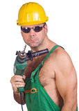 Serviceman with hand drill Royalty Free Stock Photo