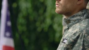 Serviceman in military uniform standing outside, sad army memories, patriotism. Stock footage stock video footage