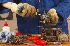 Serviceman repairing old car engine fuel pump Stock Photo