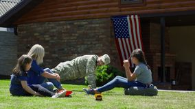 Military man with family in backyard stock photos