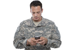 Serviceman Texting Stock Image