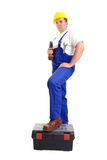 Serviceman With Driller Royalty Free Stock Photography