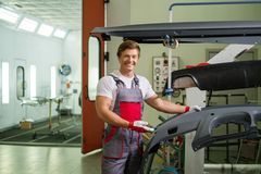Serviceman in a workshop Royalty Free Stock Image