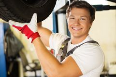Serviceman in a workshop Stock Image