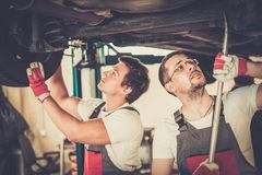 Servicemen in a car workshop Stock Photos