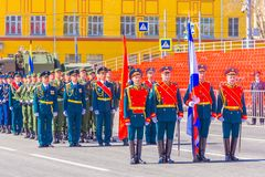Servicemen of the guard of honor carry the banner of Victory and the Russian tricolor at the ceremonial march of the military par. Russia, Samara, May 2018 royalty free stock image