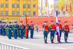 Servicemen of the guard of honor carry the banner of Victory and the Russian tricolor at the ceremonial march of the military para. Russia, Samara, May 2018 royalty free stock image