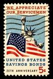Servicemen -Savings BondStamp. Honoring American servicemen and US savings bonds. Issued 1966 royalty free stock photo