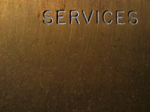 Services. A brass door plaque labelled Services Royalty Free Stock Images
