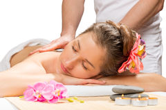 Services of a professional massage in the spa. Complex stock photo