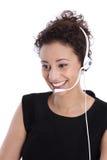 Servicetelefonoperatör med hörlurar med mikrofon: isolerad ung affärswom royaltyfria bilder
