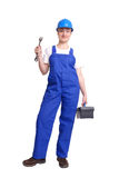 Servicewoman. Wearing blue helmet and overall holding black toolbox in one hand and flat wrench in another hand over white background Stock Images