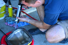 Servicing axle on truck, DIY maintenance Royalty Free Stock Photo