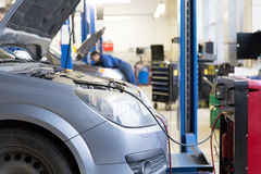 Servicing car air conditioner. In auto repair shop Stock Image
