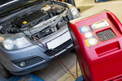 Servicing car air conditioner. In vehicle service or repair workshop Stock Images
