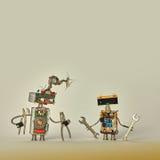 Servicio de los trabajadores de construcción Los robots creativos del juguete del diseño con los alicates dan la llave en brazos  Fotografía de archivo