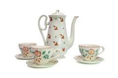 Servicio de té blanco con los escaramujos Foto de archivo libre de regalías