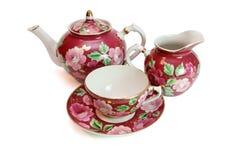 Servicio de té con el modelo floral Imagen de archivo libre de regalías