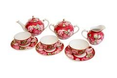 Servicio de té rojo hermoso aislado fotografía de archivo libre de regalías