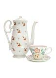 Servicio de té blanco con los escaramujos Foto de archivo