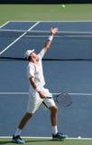 Servicio del tenis de Isner Imagen de archivo