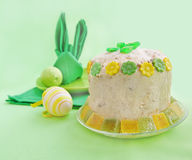 A serviette is built in form easter rabbit. Holiday serving of Easter table with serviettes and easter curd pie Royalty Free Stock Image