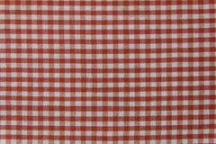 Serviette de pique-nique avec les rayures blanches et rouges Photo stock