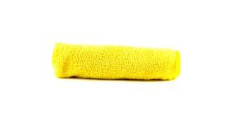 Serviette jaune enroulée Photographie stock libre de droits