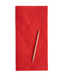 Serviette rouge sur le fond blanc Photos stock