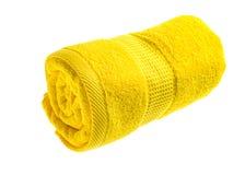Serviette roulée par jaune Photographie stock
