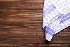 Serviette sur le fond en bois Photos stock