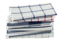 Serviettes de cuisine pliées dans différents modèles Images stock