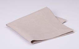 Servilleta de lino natural en el fondo blanco Imagen de archivo libre de regalías
