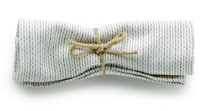 Servilleta doblada del algodón imagen de archivo