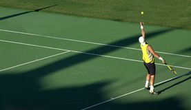 Serving. Professional Tennis Player Serving Royalty Free Stock Images