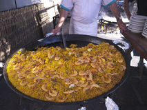 Serving A Huge Pan Of Paella On The Burriana Beach In Nerja Andalucia Spain Royalty Free Stock Photography