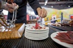 Serving acorn-fed Iberian ham Stock Photography