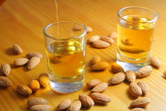Serving amaretto almond licquor Royalty Free Stock Photos