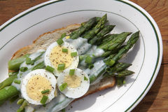 Serving Of Asparagas On Toast Topped With Béchamel Sauce Royalty Free Stock Photos