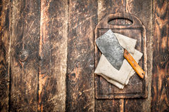 Serving background. Old hatchet on a chopping Board. Royalty Free Stock Photography