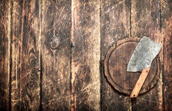 Serving background. Old hatchet on a chopping Board. Stock Photo
