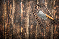 Serving background. Old hatchet on a chopping Board. Royalty Free Stock Image