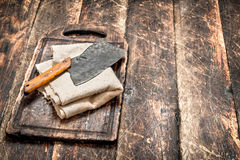 Serving background. Old hatchet on a chopping Board. Stock Photos
