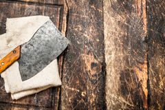 Serving background. Old hatchet on a chopping Board. Royalty Free Stock Photos