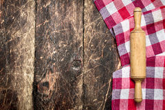 Serving background. Rolling pin with cloth. Stock Image