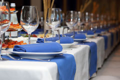 Serving banquet table in a restaurant in blue and white style Stock Photos