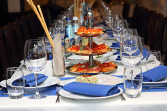 Serving banquet table in a restaurant in blue and white style Stock Images