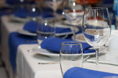 Serving banquet table in a restaurant in blue and white style Royalty Free Stock Images